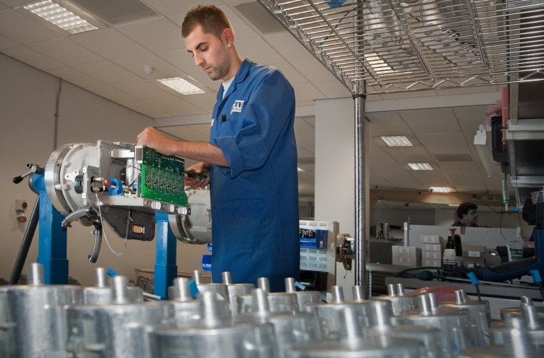 A technician employed at Zytek Automotive, based at Fradley near Lichfield, assembling an electric motor
