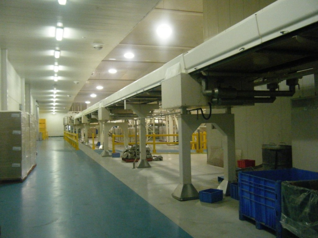 The sheer size of this food processing site works against connectivity (Figure 1A). Add a green ribbon border for pedestrian traffic (Figure 1B) that introduces colour and beauty into an otherwise beige production landscape and we also gain a mechanism which literally connects the far-flung departments of the central value stream. The inclusiveness of this device is amplified when we add a hatched cross walk for forklifts.